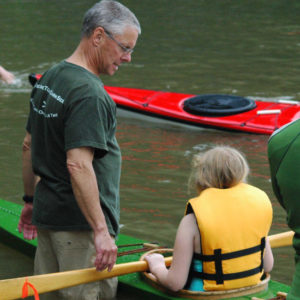 Dave Sides with a young paddler